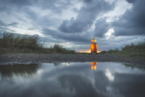 Germany, Schleswig-Holstein, Sylt, Kampen, cross light in dunes at sunset after rainfall - KEBF00923
