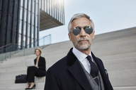 Portrait of mature businessman wearing mirrored sunglasses - RORF01476