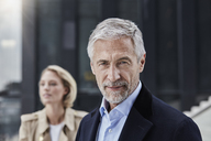 Portrait of mature businessman with grey hair and beard outdoors - RORF01518