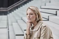 Portrait of blond businesswoman on stairs - RORF01521