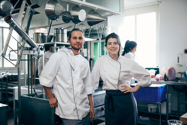 Portrait of confident chefs standing in commercial kitchen - MASF08657