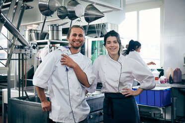 Portrait of chefs smiling in commercial kitchen - MASF08660