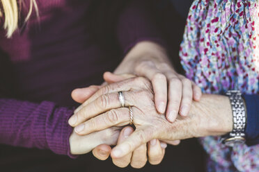 Cropped image of granddaughter and grandmother holding hands - MASF08933