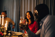 Friends drinking wine at dinner party - MASF09038