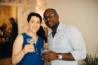 Portrait of multi-ethnic friends enjoying drinks in party at home - MASF09074