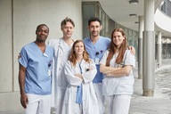 Portrait of confident multi-ethnic healthcare workers standing at hospital - MASF09188