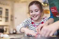 Happy girl baking - HOXF03862