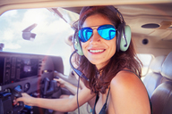 Portrait smiling, confident young woman flying airplane - CAIF21765