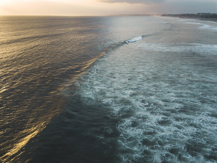 Indonesia, Bali, Aerial view of Padma beach at sunset - KNTF01392