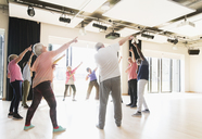 Active seniors dancing, exercising and stretching in circle - CAIF21872
