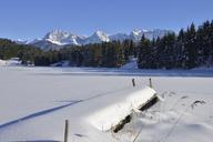Germany, Werdenfelser Land, Kruen,  view to Karwendel mountains and frozen snow-covered Lake Geroldsee - RUEF01922