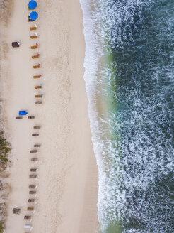 Indonesia, Bali, Aerial view of Balangan beach, empty sun loungers - KNTF01404