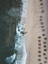 Indonesia, Bali, Aerial view of Balangan beach, empty beach loungers from above - KNTF01419