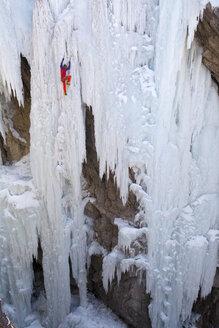 A man ice climbing near Ouray, Colorado. - AURF04043