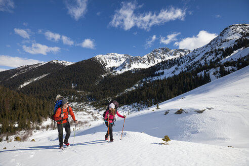 A young active couple hiking on snow. - AURF04127