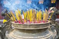 Burning incense sticks at Thien Mu Pagoda, Hue, Vietnam - AURF04373