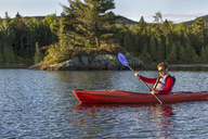 A Man Paddles His Kayak On Long Pond In Maine's North Woods Near Greenville, Maine - AURF04502