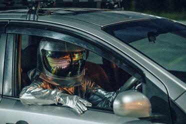 Spaceman sitting in car at night - VPIF00687