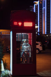 Spaceman standing in a telephone box at night - VPIF00750