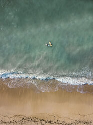 Indonesia, Bali, Aerial view of Pandawa beach, two surfers - KNTF01442