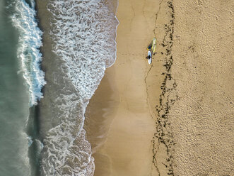 Indonesia, Bali, Aerial view of Pandawa beach, two surfers - KNTF01445