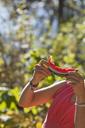 A woman eating watermelon. - AURF04684