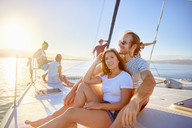 Couple relaxing on sunny boat - CAIF22112