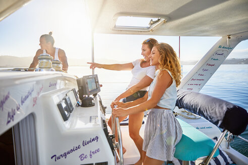 Women at helm of boat - CAIF22130