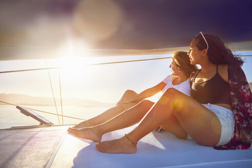 Young women relaxing on sunny boat - CAIF22133
