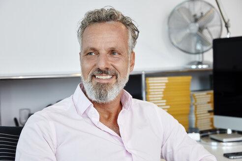 Portrait of smiling businessman in office - RHF02134