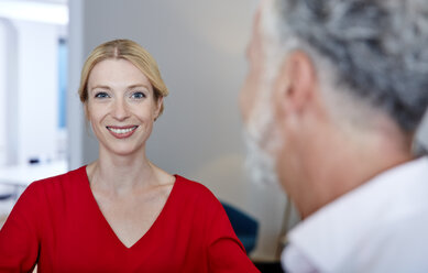 Portrait of smiling young woman with mature colleague in office - RHF02179