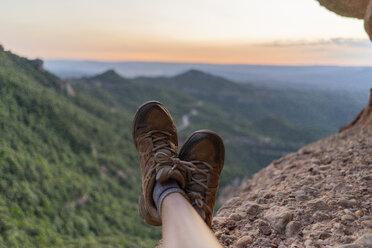 Spain, Barcelona, Montserrat, feet of resting man - AFVF01556
