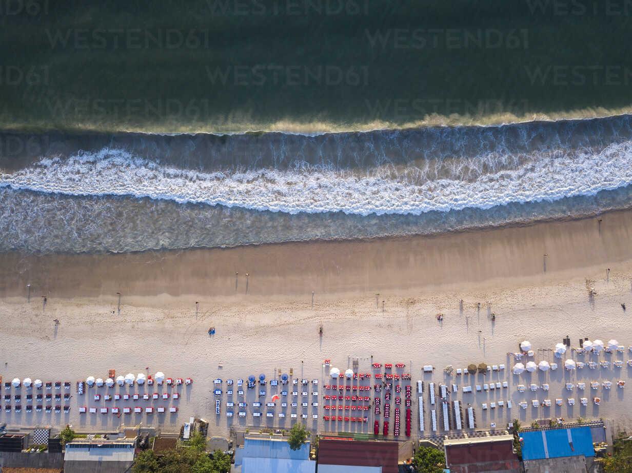 Indonesia, Bali, Aerial view of Jimbaran beach, Restaurants at the beach, from above - KNTF01455 - Konstantin Trubavin/Westend61