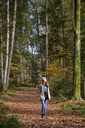 Redheaded teenage girl enjoying autumnal forest - LBF02052
