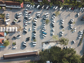 Indonesia, Bali, Aerial view of Car parking near Tanah Lot-temple - KNTF01503