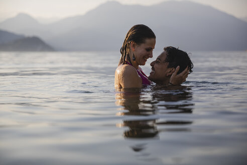 Happy affectionate young couple in a lake - MRAF00282