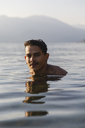 Portrait of smiling young man in a lake - MRAF00285