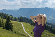 Germany, Bavaria, Brauneck near Lenggries, happy young woman in alpine landscape - LBF02071