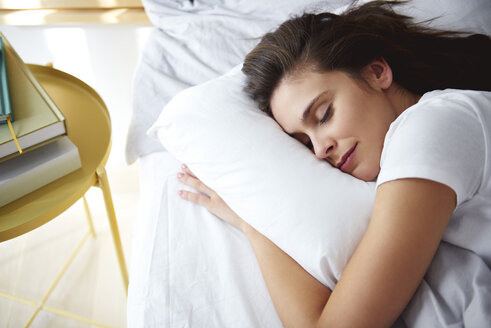 Portrait of woman sleeping in bed at day - ABIF01006
