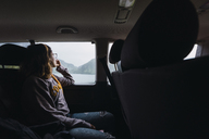 Norway, young woman in a car looking out of window - KKAF01916