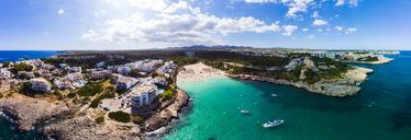 Spain, Mallorca, Portocolom, Aerial view of Punta des Jonc, Bay of Cala Marcal, beach - AMF05912