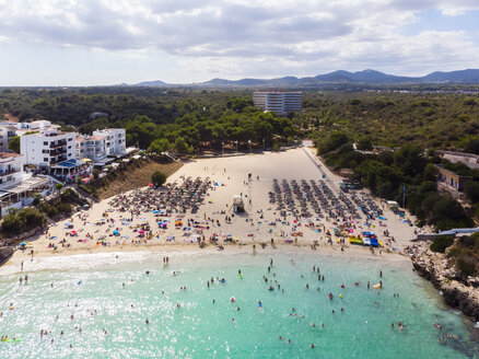 Spain, Mallorca, Portocolom, Aerial view of Punta des Jonc, Bay of Cala Marcal, beach with tourists - AMF05918