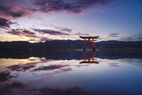 Japan, Hiroshima, Miyajima, Itsukushima Shrine at Seto Inland Sea at sunset - EPF00486
