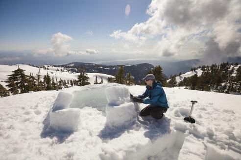 Building an igloo on Seymour Mountain, Vancouver, British Columbia, Canada. - AURF04918