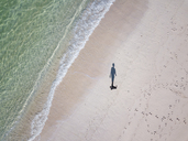 Indonesia, Bali, Aerial view, beach stroll, shadow of person - KNTF01603