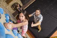 High Angle View Of Family Playing On A Climbing Gym In House - AURF05170