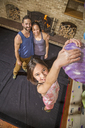 Mother And Father Looking At Their Daughter Climbing Gym Wall At Home - AURF05326