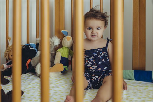 Portrait of baby girl sitting in bed - MFF04706