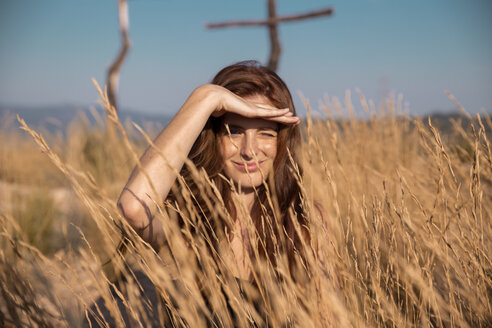 Young woman in the countyside looking out - AFVF01566