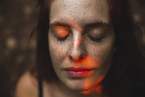 Portrait of young woman with freckles closing her eyes - AFVF01578